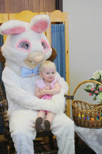 easter bunny with toddler on lap