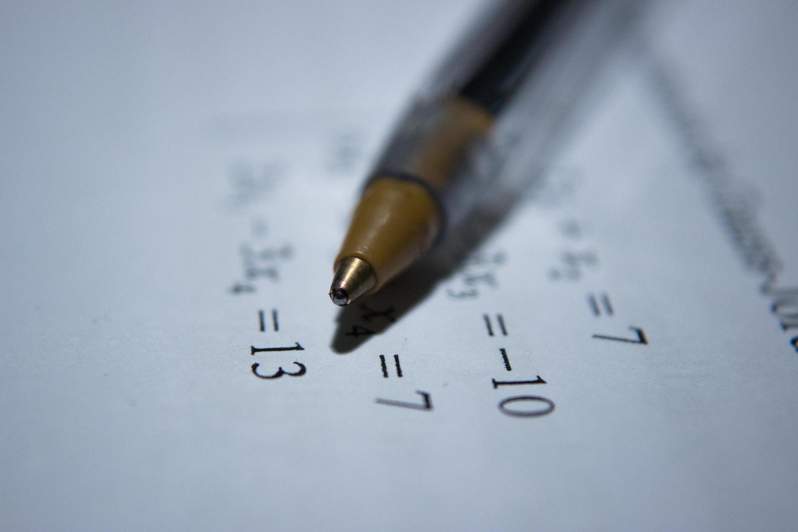 ballpoint pen and math homework