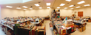 panoramic image of tables with used books on top