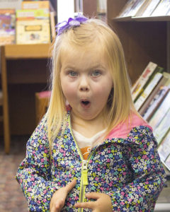 child making surprised face